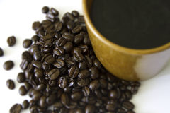 Cup of coffee and coffee beans. Stock Image