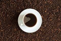 Cup of coffee on a coffee beans background Royalty Free Stock Images