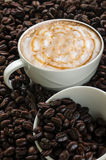 Cup of coffee on coffee beans background,selected focus. Royalty Free Stock Photo
