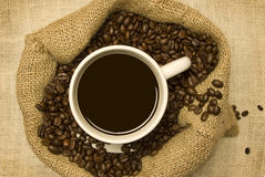 Cup of Coffee With Coffee Beans and Bag Royalty Free Stock Images