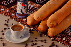 Cup of coffee with coffee beans and baguette Royalty Free Stock Image