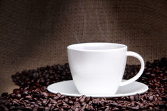Cup of coffee with coffee beans on a beautiful background. Stock Photography