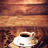 Cup of coffee with coffee beans on a beautiful wooden  brown bac Royalty Free Stock Photo