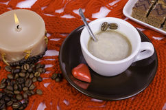 Cup of coffee, coffee beans and candle. Royalty Free Stock Photography