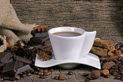 Cup of coffee with coffee beans, chocolate and spices Royalty Free Stock Photos
