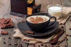 Cup of coffee with coffee beans and chocolate Royalty Free Stock Image