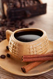 Cup of coffee with coffee beans and cinnamon bars Stock Photos