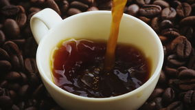 A cup of coffee with coffee beans stock video footage