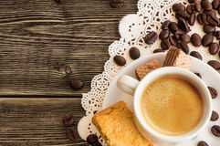 A cup of coffee with coffee beans Royalty Free Stock Image