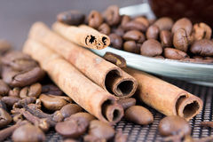 A cup of coffee with coffee beans and cinnamon sticks Royalty Free Stock Image