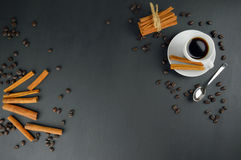 Cup of coffee and coffee beans, cinnamon sticks. Stock Photography