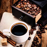 Cup of coffee with coffee beans and Coffee grinder on wooden bro Royalty Free Stock Photography