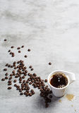 Cup of coffee and coffee beans on concrete background Stock Photo