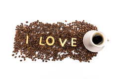 Cup of coffee and coffee beans with cookies in shape of Love word Stock Image