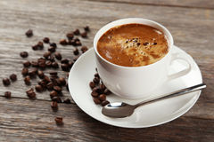 Cup of coffee with coffee beans on a grey wooden background Stock Photo