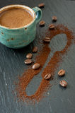 Cup of coffee, coffee beans and ground coffee Royalty Free Stock Images