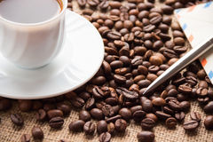A cup of coffee, coffee beans;  letter and  pen Royalty Free Stock Image