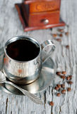 Cup of coffee, coffee beans and mill Royalty Free Stock Image