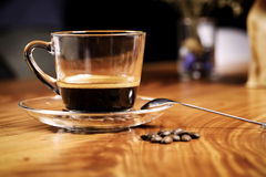 A cup of coffee and coffee beans Royalty Free Stock Image