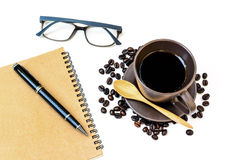 Cup of coffee with coffee beans and notebook isolated Royalty Free Stock Image