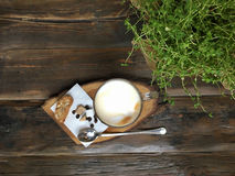 Cup of coffee and coffee beans on old wooden table Royalty Free Stock Photos