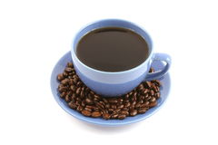 Cup of coffee with coffee beans on plate Stock Photo