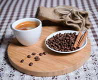 Cup of coffee and coffee beans on a plate Stock Images