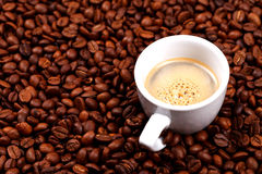 Cup of coffee on coffee beans Royalty Free Stock Images