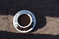 Cup of coffee, coffee beans Stock Image
