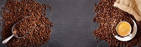 Cup of coffee and coffee beans in a sack, top view Royalty Free Stock Photography