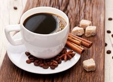 Cup of coffee, coffee beans and sugar cubes. Close-up. Royalty Free Stock Image