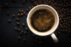 Cup of coffee with coffee beans  top view Royalty Free Stock Photos
