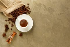 A cup of coffee and coffee beans. Top view stock photography