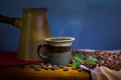 Cup of coffee, coffee beens and leaves Royalty Free Stock Images