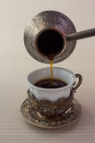 Cup of coffee and coffee brewing pot Stock Photography