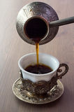 Cup of coffee and coffee brewing pot Royalty Free Stock Photography