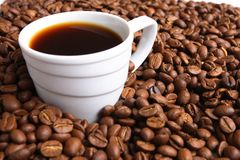 Cup coffee And coffee grain Royalty Free Stock Images