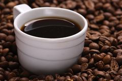 Cup coffee And coffee grain Royalty Free Stock Photo