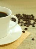 Cup of coffee with coffee grain Stock Photos