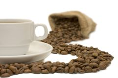 Cup from coffee on coffee grains Stock Images