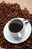 Cup of coffee on coffee grains Royalty Free Stock Images