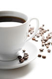 Cup of coffee with coffee grains Stock Image