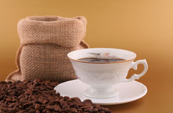 Cup of coffee and coffee grains Stock Images