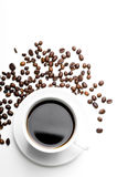 Cup of coffee with coffee grains isolated on white Royalty Free Stock Image
