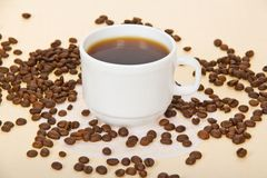 Cup with coffee, coffee grains, a napkin Stock Images