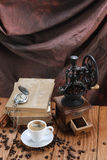 Cup of coffee, coffee grinder, coffee beans, antique clocks, old Royalty Free Stock Images