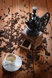 Cup of coffee, coffee grinder, coffee beans in a sack Royalty Free Stock Photography