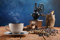 Cup of coffee, coffee grinder, coffee beans in a sack Royalty Free Stock Image