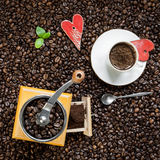 Cup of coffee and coffee grinder Royalty Free Stock Photo