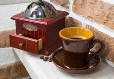 Cup of coffee, coffee grinder. still life Stock Photo